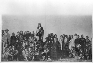 Little Bear (standing in center) and other Cree - 1909